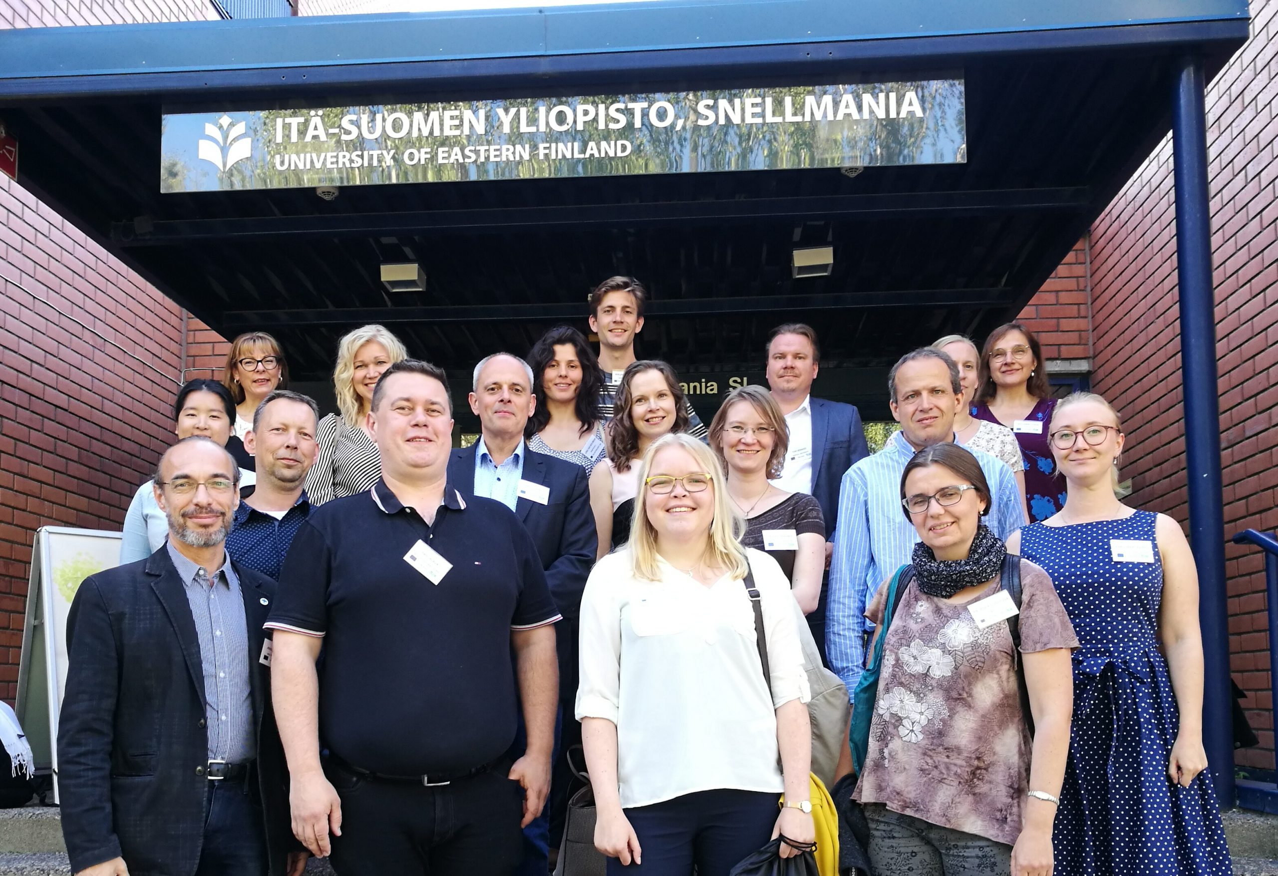 Group picture of consortium members at the entrance of the University of Eastern Finland